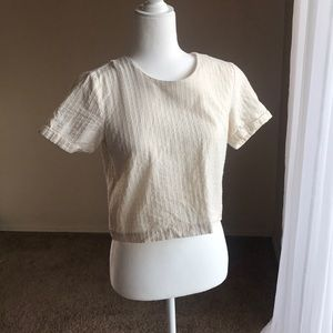 Cream crop top with buttons in the back